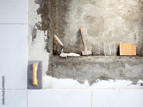 Photo  construction tools notched trowel and hammer