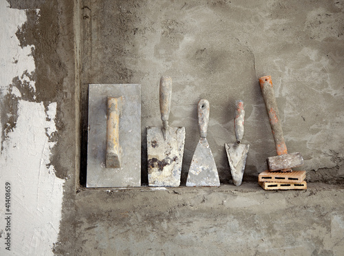 Photo  aged construction cement mortar used tools