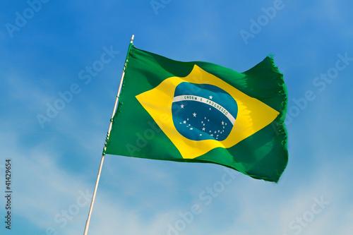Fotografie, Obraz  Brazil flag flutters against Brazilian blue skies