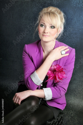 Business look of young Slavonic stylish girl with blond hair Wallpaper Mural