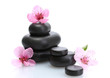 Spa stones and pink sakura flowers isolated on white.