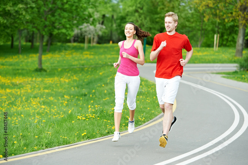 Poster Jogging Young man and woman jogging outdoors