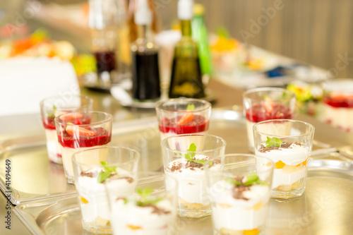 Foto op Aluminium Buffet, Bar Creamy cup desserts on silver tray cafeteria