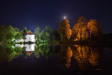 Church On The Water At Night In Zwierzyniec, Poland.