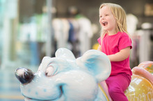 Adorable Baby Ride On Carousel In Mall