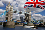 Tower Bridge with boat and  flag of England in London - 41643043