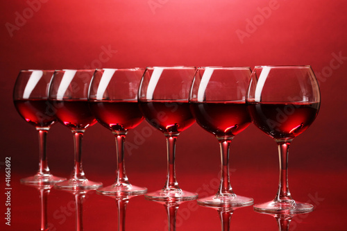 Wineglasses on red background - 41663692