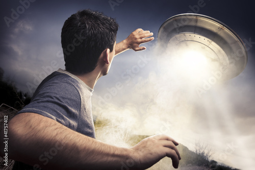 Man about to be abducted by aliens Poster