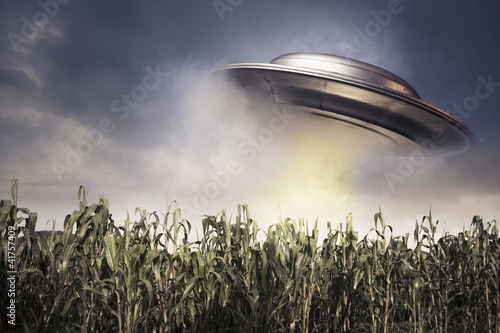 Foto op Canvas UFO UFO hovering over a crop field
