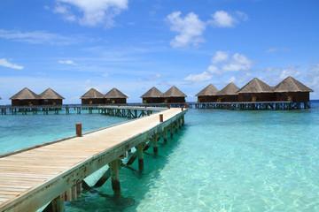 Long wooden bridge and water villas,Maldives