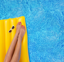 Woman Relaxing In A Pool - Fee...