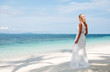 Beautiful bride on tropical sea side background