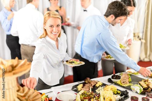 Fotografie, Obraz  Business woman serve herself at buffet