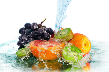 Obraz na Szkle Do jadalni fruit in a spray of water