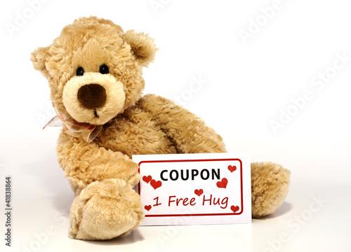 Fotografie, Obraz  Teddy bear with hug coupon