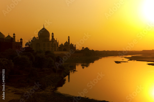 Fotobehang India Taj Mahal with the Yamuna River at sunset, India.