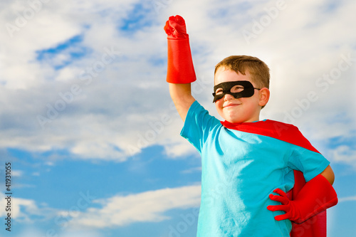 Photo  Child pretending to be a superhero