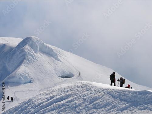 Climbers on edge of crater of volcano Beerenberg, Jan Mayen