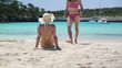 Female friends on beautiful tropical beach, dolly shot