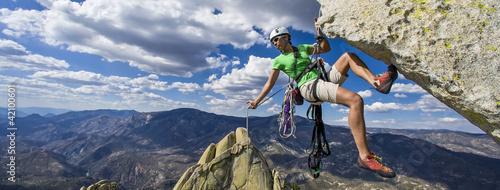 Photo Climber rappels.