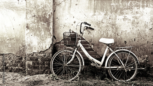 Recess Fitting Bicycle Old bicycle and craked wall