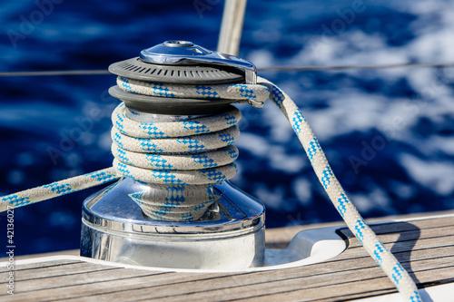 Sailing boat winch with rope closeup Fototapeta