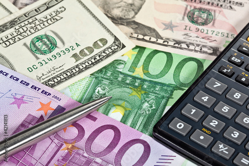 Money Calculator And A Pen