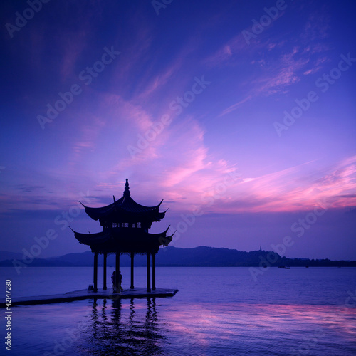 Prune west lake with sunset in hangzhou,China. .