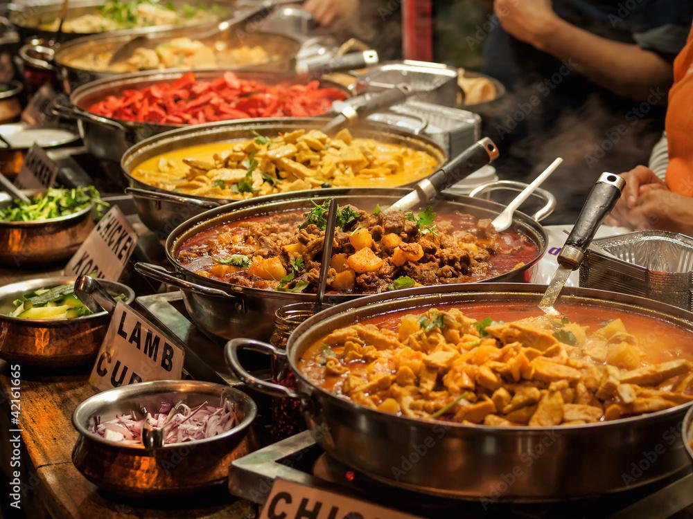Fototapeta Oriental food - Indian takeaway at a London's market