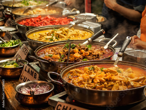 Tuinposter Eten Oriental food - Indian takeaway at a London's market