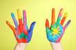 Brightly colored hands on green background