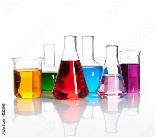 Photo Set of laboratory flasks with a colored reagents, isolated