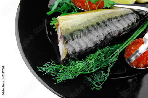 fish and caviar on plate