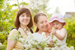 Happy women and kid at summer garden