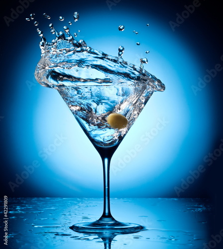 Canvas Prints Splashing water Splash martini from flying olives.
