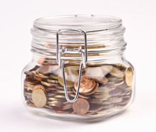 Preserves Jar Filled With Coin...