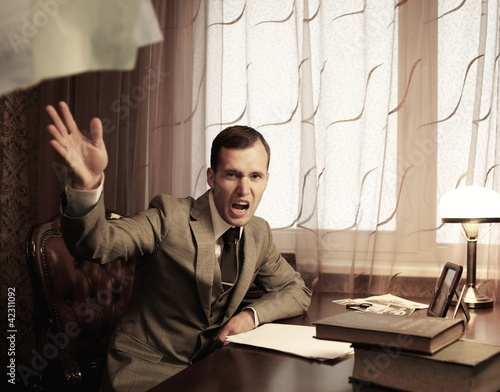Valokuva  Angry businessman throwing a documents