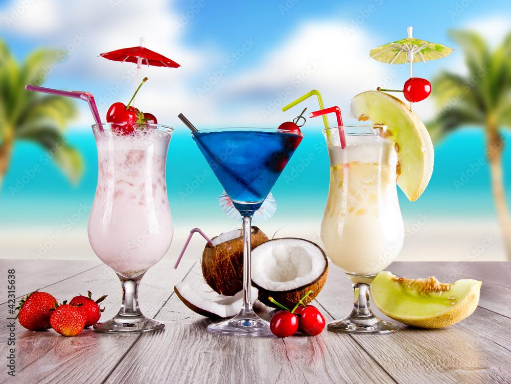 Fototapeta Summer drinks with blur beach on background - obraz na płótnie