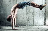 Young man sports exercises - 42331240