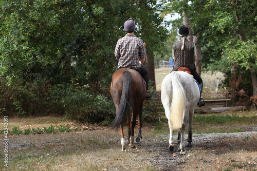 Equitation Couple riding in the countryside