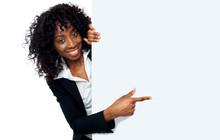 Female Representative Pointing Towards Placard