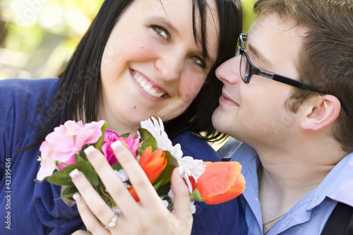 Fotografie, Obraz  Attractive Young Man Gives Flowers to His Love