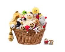 Stuffed Animal Toys In A Basket .isolated On A White Background
