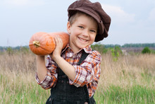 Smiling Boy With Pumpkin On Hi...