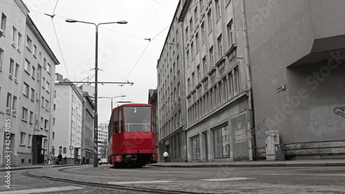 Poster Rouge, noir, blanc Red tram in the bw city.