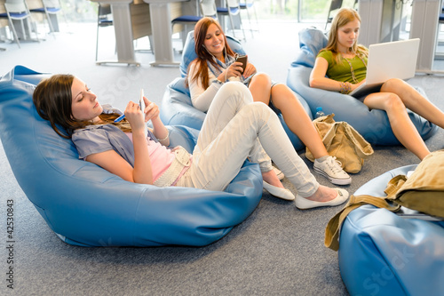 Group of students relax on beanbag Wallpaper Mural