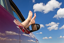 Woman Legs Out Of Car Window