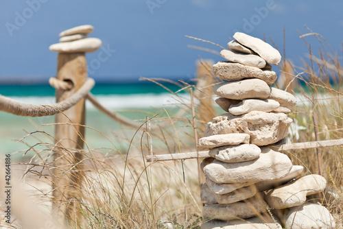 Acrylic Prints Stones in Sand Balanced stones near the beach. Formentera island. Spain.