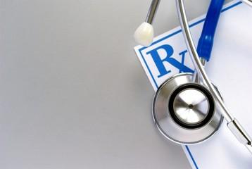 stethoscope and a prescription form
