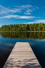 Wooden Pier On Lake Symmetrica...